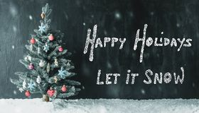 Colorful Decorated Tree, Calligraphy Happy Holidays, Let It Snow, Snowflakes. Black Cement Background With English Calligraphy Happy Holidays, Let It Snow stock photos