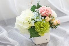 Colorful decoration artificial flower in enamel vase Royalty Free Stock Images