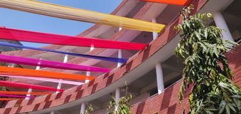 Colorful decoration with clothes on an tall building. Colorful decoration with clothes on an building royalty free stock photos