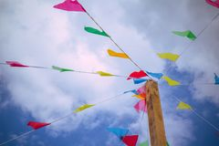 Colorful decoration flags against blue sky background on a summer festival happy and joyful playing kids, games. summer blue  . Royalty Free Stock Images