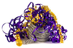 Colorful decoration for New Year`s Eve or Mardi Gras celebration. Purple and gold ribbons with bracelets. Purple and gold ribbon with diamond bracelets. New stock photography