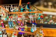 Colorful decoration for sale. Earrings handmade, Luang Prabang, Laos. Close-up. Colorful decoration for sale. Earrings handmade, Luang Prabang, Laos. Close-up royalty free stock images