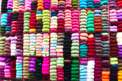 Colorful Decorations. Colorful decorative wool balls for weaving sweaters background stock photo