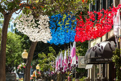 Colorful decorations  from garlands over streets during the Madeira Wine Festival in Funchal on Madeira Island. Portugal Royalty Free Stock Images