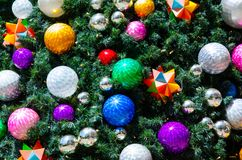 Colorful decorative balls on Christmas tree in close-up for background. A Colorful decorative balls on Christmas tree in close-up for background Royalty Free Stock Photos