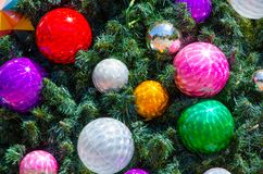 Colorful decorative balls on Christmas tree in close-up for background. A Colorful decorative balls on Christmas tree in close-up for background Royalty Free Stock Photography