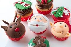 Colorful decorative Christmas cupcakes Stock Photos