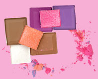 Colorful Decorative cosmetics on pink background. Top view. Stock Photos