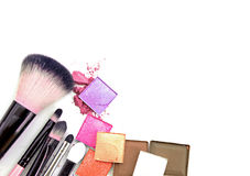 Colorful Decorative cosmetics on white concrete floor workplace. Top view. Colorful Decorative cosmetics on white concrete floor workplace. Top view Royalty Free Stock Photos