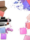 Colorful Decorative cosmetics on white concrete floor workplace. Top view. Colorful Decorative cosmetics on white concrete floor workplace. Top view Royalty Free Stock Photography