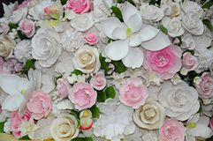 Colorful fondant wedding flowers. Colorful decorative fondant wedding cake flowers royalty free stock photography
