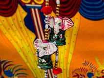 Colorful decorative items in tribal art fair. Colorful handcrafted Ganesha idol for home decoration at tribal art and handicraft fair held in India. Rajasthan royalty free stock photos