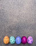 Colorful decorative painted eggs for Easter  granite background top view close up Stock Photos