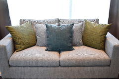 Colorful decorative pillow on a casual sofa Royalty Free Stock Images