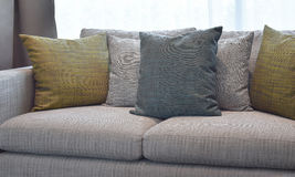 Colorful decorative pillow on a casual sofa in living room Stock Image