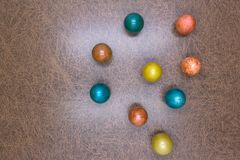 Colorful decorative and plain easter eggs arranged in random circular pattern on green grass. Close up flat view from above. stock photos