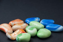 Colorful decorative stones on a black background Royalty Free Stock Image