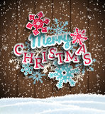 Colorful decorative text Merry Christmas on wooden Stock Photos