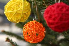 Colorful decorative wooden balls on Christmas tree Royalty Free Stock Images