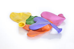 Colorful deflated heart-shaped balloons Stock Photos
