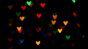 Colorful defocused blinking heart bokeh festive lights as abstract background. 1920x1080 full hd footage stock video footage