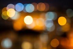 Colorful defocused bokeh lights in blur night background.  stock photos