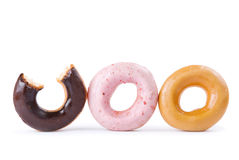 Colorful delicious donut in a row Stock Image