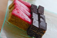 Colorful and delicious chocolate home made small cakes arranged Stock Images