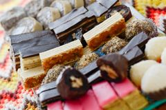 Colorful and delicious home made small cakes arranged on glass p Royalty Free Stock Images