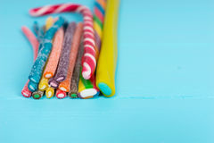 Colorful delicious licorice candies on wooden board Royalty Free Stock Images