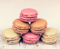 Colorful  delicious macaroons on vintage wooden background Stock Images