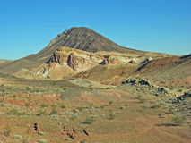 Lava Butte near Lake Las Vegas, Nevada. Colorful desert geologic formations with the prominent Lava Butte in the background made of basalt from volcanic royalty free stock image