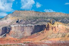 Colorful desert landscape with strata of yellow, orange, red, and purple in the American Southwest. Dramatic rock formations with colorful strata in the desert stock image