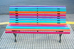 Colorful design bench on the street Royalty Free Stock Photo