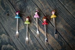 Colorful Dessert Forks with Colorful Trinket Handles on Blue Royalty Free Stock Images