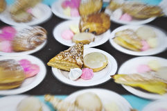 Colorful Desserts. Abstract blue of a colorful sweet deserts table at a party, including almond pastries, carmel frosted cookies, and meringue Stock Photography