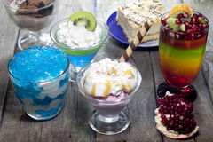 Colorful desserts mixed assortment. Colorful desserts with jelly mixed assortment royalty free stock photography
