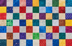 Colorful detail of quilt sewn from square pieces Stock Image