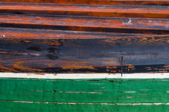 Colorful detail of a wooden fishing boat. Particularly colorful red and green bow of a wooden fishing boat Stock Image