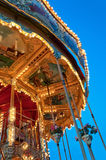Colorful & Detailed Carousel. Carousel lights up beautifully and the sun sets in the Cape Town V&A Waterfront Stock Image