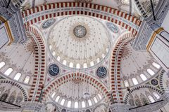 Colorful and detailed ceiling of a mosque stock image