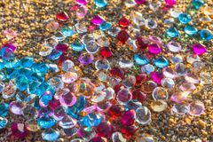 Colorful diamonds on the beach Royalty Free Stock Photo
