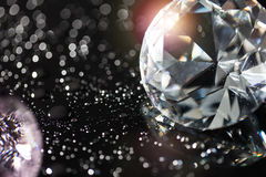 Colorful diamonds and bokeh background. Colorful round diamond on shiny bokeh background Stock Images