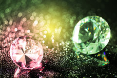 Colorful diamonds and bokeh background. Colorful round diamond on shiny bokeh background Royalty Free Stock Images