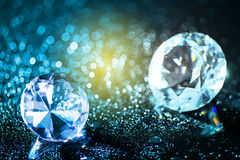 Colorful diamonds and bokeh background. Colorful round diamond on shiny bokeh background Royalty Free Stock Photos