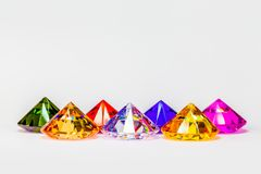 Colorful diamonds in white background. With copy space Royalty Free Stock Photography