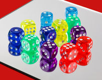 Colorful dice. A closeup of plastic colorful dice on a mirror Stock Photography