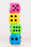 Colorful dice isolated on blurry background Royalty Free Stock Photography