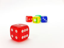 Colorful dice. Red dice among other color dices Royalty Free Stock Image