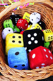 Colorful dice in wooden basket Stock Photo